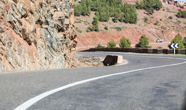 Empty waved road in Atlas mountains low angle shot at curve edge Royalty Free Stock Images