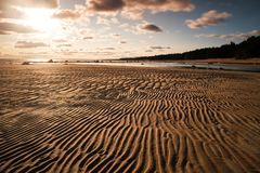 Empty waved sand near lake in summer evening in Russia Royalty Free Stock Photography