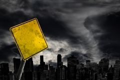 Empty Weather Warning Sign Against City Silhouette With Copy Spa Royalty Free Stock Photo