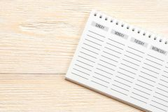 Empty week planner on white office table, week start concept stock photos