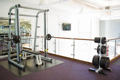 Empty weights room with bench press Stock Photography