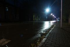 Empty wet road after rain in the city. Empty wet road after rain in the Stock Image