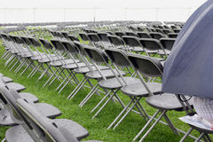 Empty wet seating outdoors Royalty Free Stock Image