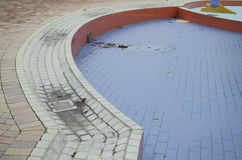 Empty Wet Swimming Pool with Leafs Stock Photo