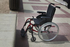 Empty wheelchair on a beach Royalty Free Stock Image