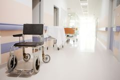 Empty wheelchair in the hallway stock photo