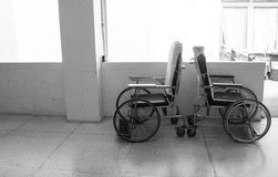 Empty wheelchair in hospital corridor Stock Photos