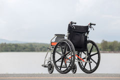 Empty wheelchair on lake. Lonely ,Empty wheelchair on lake Royalty Free Stock Image