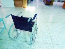 Empty wheelchair in lobby of a hospital Stock Photos