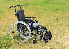 Empty wheelchair on meadow Royalty Free Stock Photography