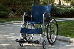 Empty wheelchair at the park, close-up, outdoors. Miracle concept stock photo