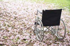 Empty wheelchair parked in hospital stock photography
