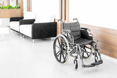 Empty wheelchair parked in hospital hallway.  Royalty Free Stock Images