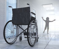 Empty wheelchair parked in hospital hallway with child figure Stock Images