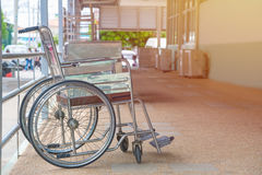Empty wheelchair parked in Patient Rooms at hospital.  Royalty Free Stock Photo