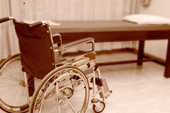 Empty wheelchair parked in treatment room Royalty Free Stock Images