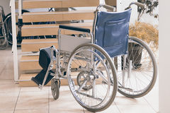 Empty wheelchair and stairs. Disabled accessibility reality. Wheelchair Royalty Free Stock Photos