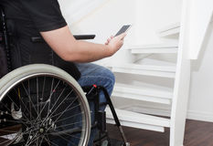 Empty wheelchair and stairs Stock Images