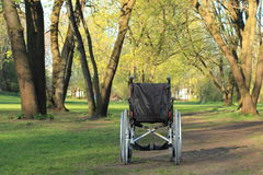 Empty wheelchair standing in a park Stock Photography