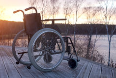 Empty wheelchair Stock Images