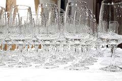 Empty whisky glasses. Lined up on a white  table cloth Royalty Free Stock Images