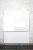 Empty white banner on wall Royalty Free Stock Image
