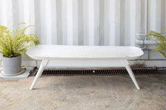 Empty bathtub bench or tub seat with sheet metal corrugated wall background. Empty white bathtub bench or tub seat with sheet metal corrugated wall background stock image