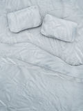 Empty white bed. Top view of an empty bed with white sheets and a pair of pillows Royalty Free Stock Images