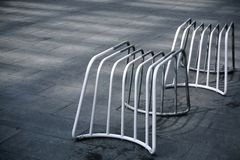 White Benches Made of Welded Steel Pipes. Empty White Benches Made of Welded Steel Pipes stock photo