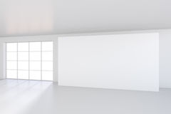 Empty white billboard in a big bright room. 3D rendering.  Royalty Free Stock Photography