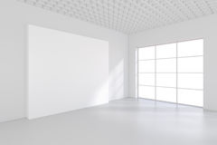 Empty white billboard in a big bright room. 3D rendering.  Royalty Free Stock Photos