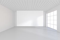 Empty white billboard in a big bright room. 3D rendering.  Stock Image