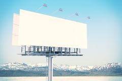 Empty white billboard in sky. Empty white billboard on bright sky background. Retail, advertisement and commerce concept. Mock up, 3D Rendering stock images