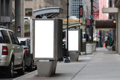 Empty white billboards on two public phone booth Royalty Free Stock Photo