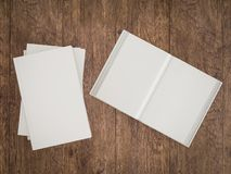 Empty white book mockup template on wood background Stock Images