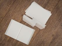Empty white book mockup template on wood background Stock Photos