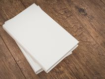 Empty white book mockup template on wood background Stock Photography