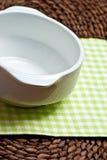 Empty white bowl on grass mat Royalty Free Stock Photos