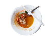 Empty white bowl of Tom Yum Kung with noodles and seafood isolat. Ed on white background, popular Thai food Stock Image