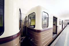 Empty white and brown wagons of underground Stock Photos