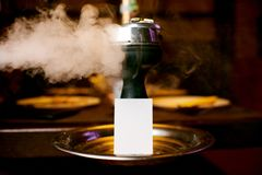 White business card stands on the hookah bowl royalty free stock images