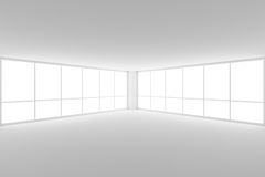 Empty white business office room corner with two large windows. Business architecture white colorless office room interior - empty white business office room Royalty Free Stock Photography