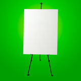 Empty white canvas and modern easel Royalty Free Stock Photography