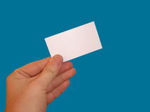 Empty white card. Isolated empty white blank card ready for text on blue background Royalty Free Stock Photography