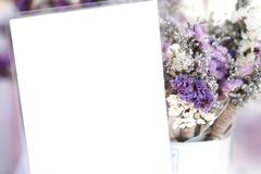 Empty white card and purple flower background. Empty white card and purple flower background Royalty Free Stock Photography