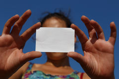 Empty white card supported by a girl Stock Images