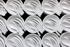 Empty white ceramic bowls and spoons Stock Photo