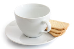Empty white ceramic cup and saucer with finger tea biscuits. Iso Stock Images