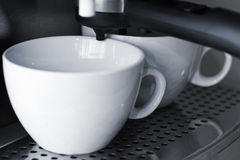 Empty white ceramic cups in espresso coffee machine Royalty Free Stock Images