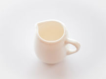 Empty white ceramic pitcher on table Stock Image